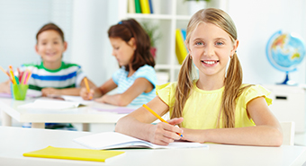 Lovely girl looking at camera with smile during lesson